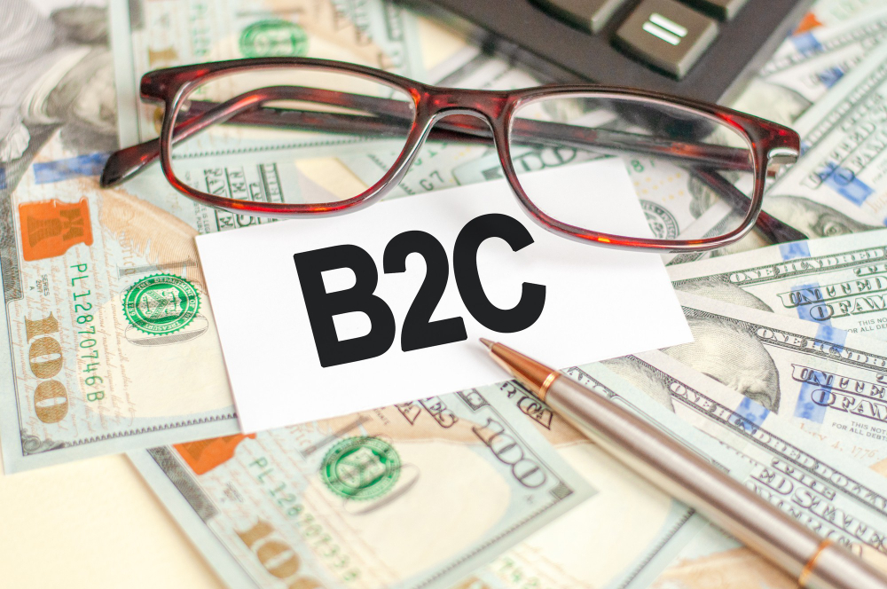 finance-business-concept-table-are-bills-glasses-pen-sign-which-it-is-written-b2c-b2c-business-consumer-1