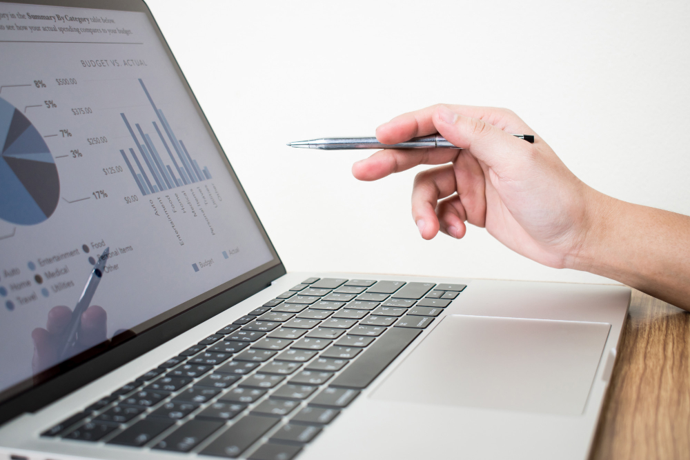 image-businessman-is-analyzing-graph-laptop-1